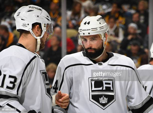 Nate Thompson talks with Kyle Clifford of the Los Angeles Kings during the third period against the Pittsburgh Penguins at PPG Paints Arena on...