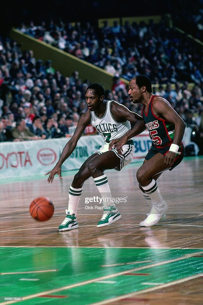Nate 'Tiny' Archibald #7 of the Bosotn Celtics drives to the basket against the Milwaukee Bucks during a game played in 1983 at the Boston Garden in Boston, Massachusetts.