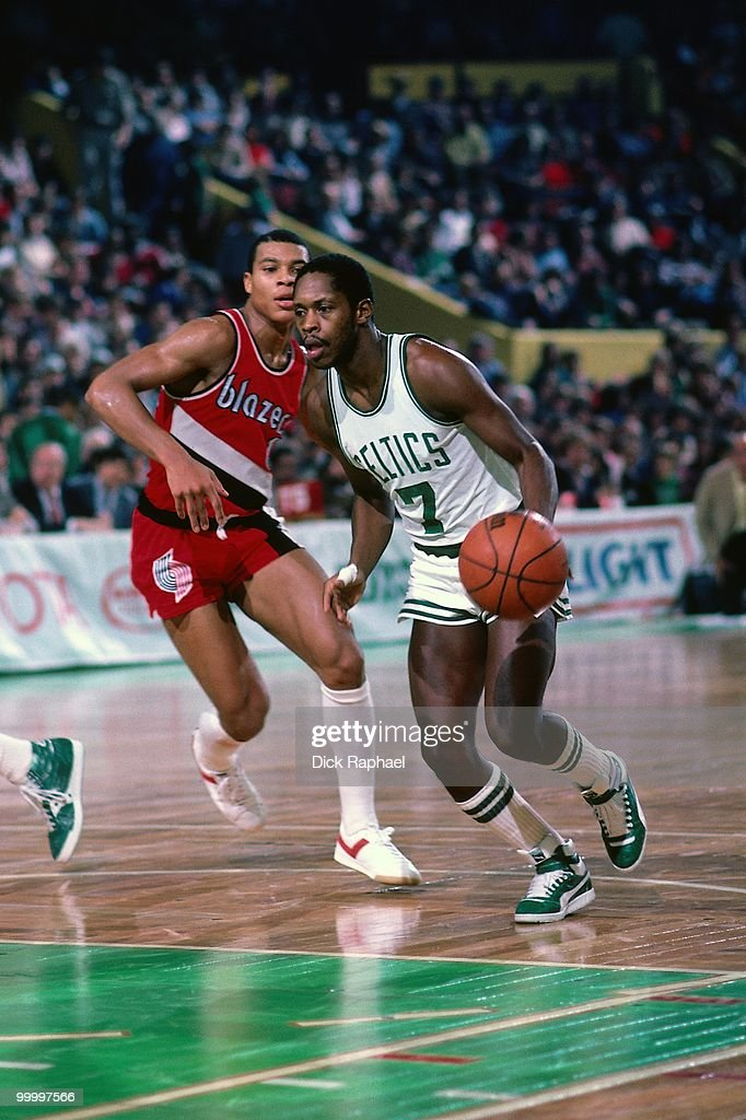 Nate 'Tiny' Archibald #7 of the Boston Celtics drives to the basket against the Portland Trail Blazers during a game played in 1983 at the Boston Garden in Boston, Massachusetts.