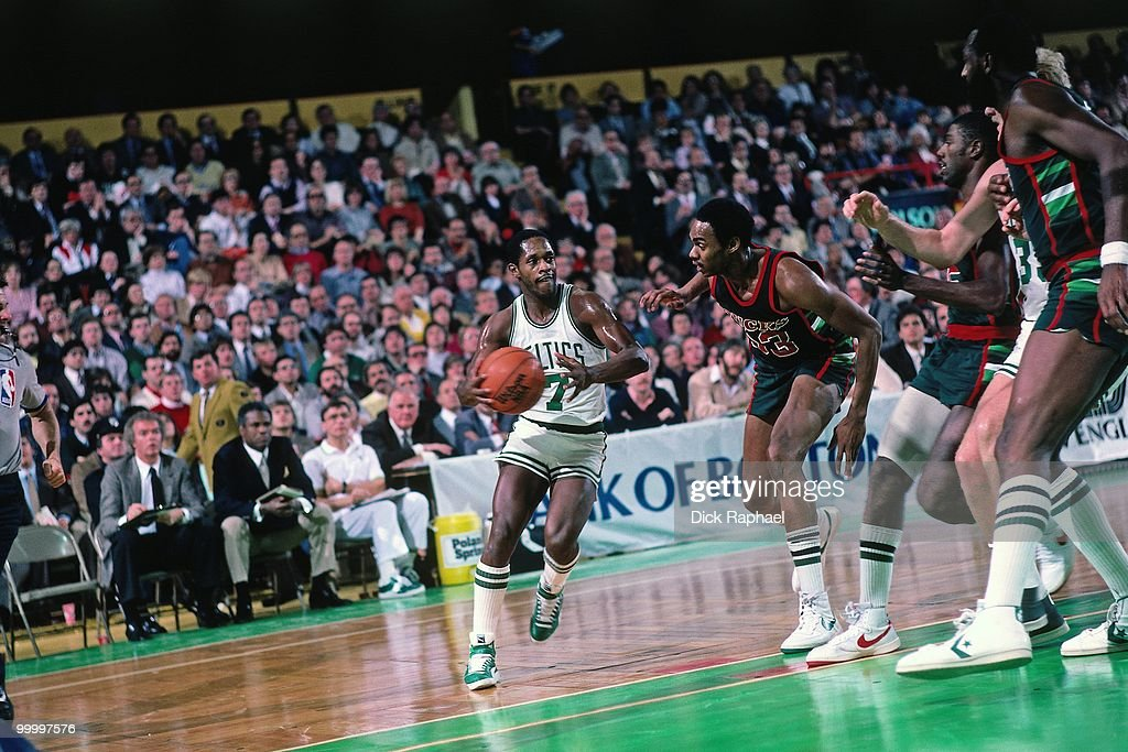 Nate 'Tiny' Archibald #7 of the Boston Celtics drives to the basket against the Milwaukee Bucks during a game played in 1983 at the Boston Garden in Boston, Massachusetts.