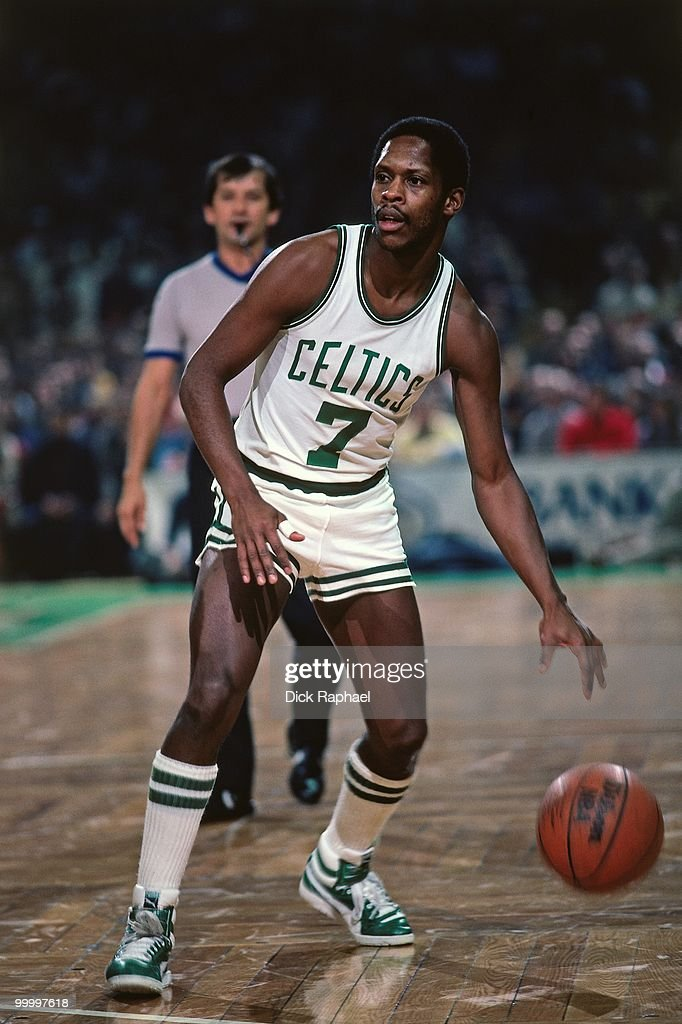 Nate 'Tiny' Archibald #7 of the Boston Celtics moves the ball up court during a game played in 1983 at the Boston Garden in Boston, Massachusetts.