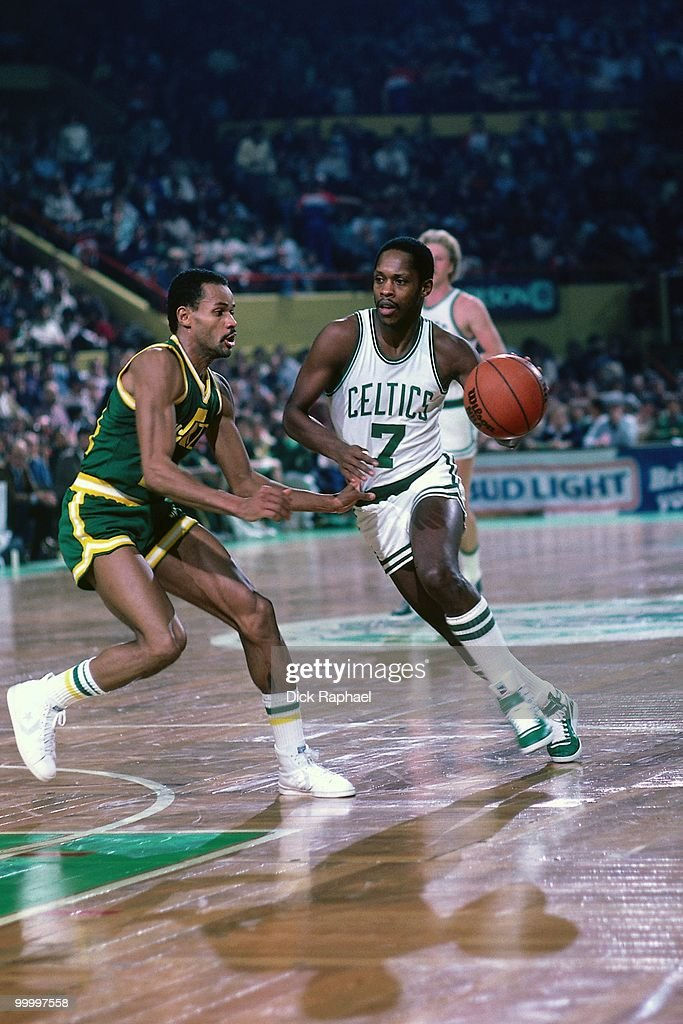 Nate 'Tiny' Archibald #7 of the Utah Jazz drives to the basket during a game played in 1983 at the Boston Garden in Boston, Massachusetts.