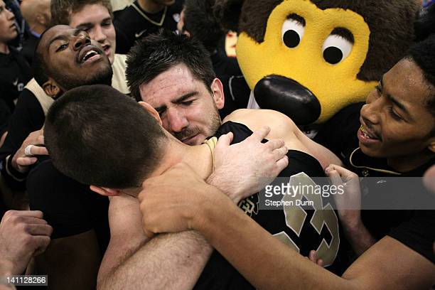Nate Tomlinson and Austin Dufault of the Colorado Buffaloes celebrate the Buffaloes 5351 victory against the Arizona Wildcats in the championship...