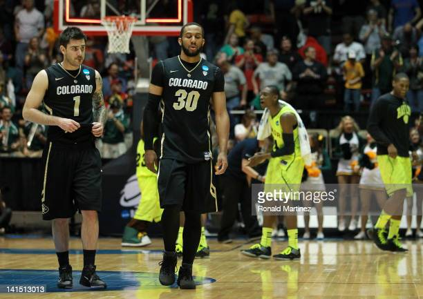 Nate Tomlinson and Carlon Brown of the Colorado Buffaloes walk off the court as the Baylor Bears celebrate their 80-63 victory during the third round...