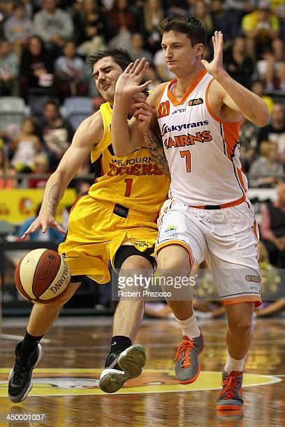 Nate Tomlinson of the Tigers and Shaun Bruce of the Taipans clash during the round six NBL match between the Melbourne Tigers and the Cairns Taipans...
