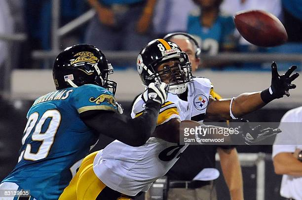 Nate Washington of the Pittsburgh Steelers attempts to catch a pass against Brian Williams of the Jacksonville Jaguars at Jacksonville Municipal...