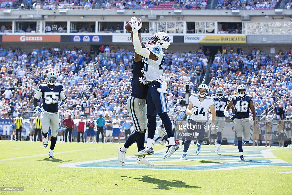 Nate Washington #85 of the Tennessee Titans catches a pass in the end zone that is ruled incomplete after a review against the Dallas Cowboys at LP Field on September 14, 2014 in Nashville, Tennessee. The Cowboys defeated the Titans 26-10.