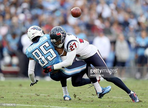 Nate Washington of the Tennessee Titans fumbles the ball after being hit by Quintin Demps of the Houston Texans during the game at LP Field on...