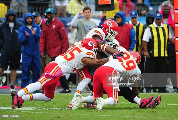 Nate Washington of the Tennessee Titans is tackled by Eric Berry, Marcus Cooper, and Quintin Demps of the Kansas City Chiefs at LP Field on October...