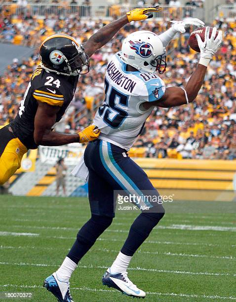 Nate Washington of the Tennessee Titans makes a catch against Ike Taylor of the Pittsburgh Steelers in the second half during the game on September 8...