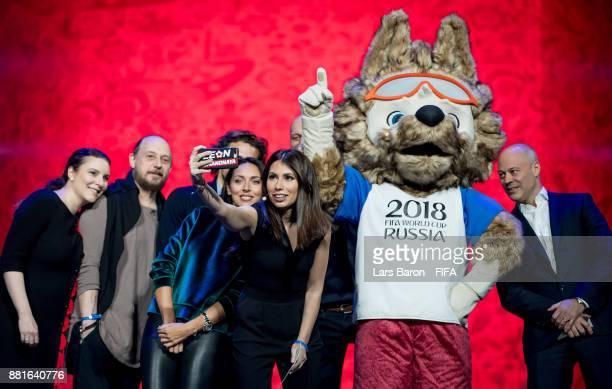 Natella Nikolau Felix Mikhailov Diego Forlan Alsou Maria Komandnay Chris Unger and Paul Redman take a selfie with the 2018 World Cup mascot Zabivaka...