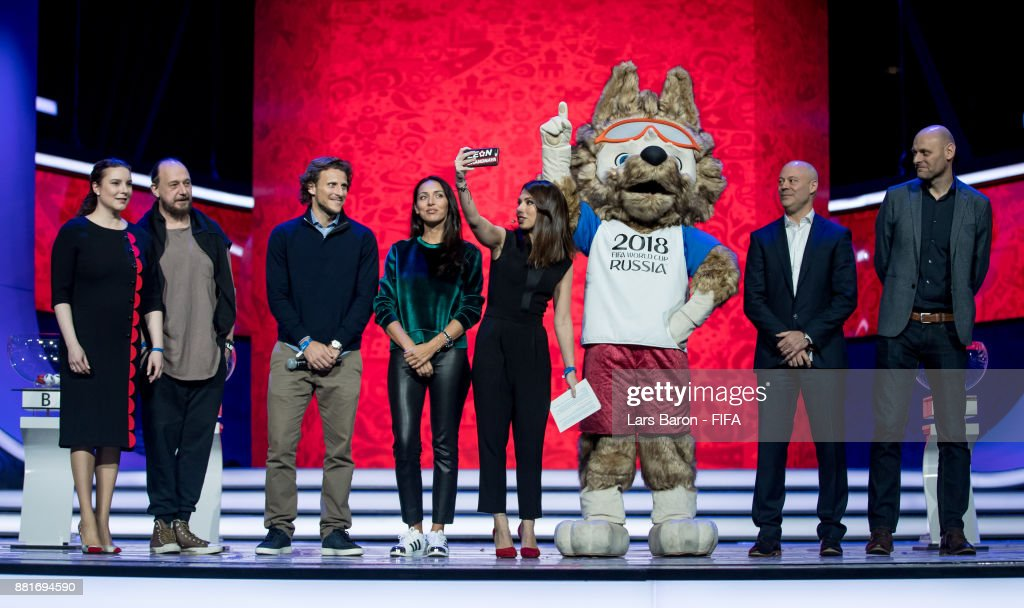 Natella Nikolau, Felix Mikhailov, Diego Forlan, Alsou, Maria Komandnay, Chris Unger and Paul Redmand take a selfie with the 2018 World Cup mascot Zabivaka during the Behind the Scenes of the Final Draw for the 2018 FIFA World Cup at the Draw hall on November 29, 2017 in Moscow, Russia.