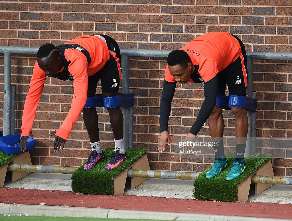 Nathainel Clyne and Sadio Mane of Liverpool during a training session at Melwood Training Ground on October 12, 2016 in Liverpool, England.