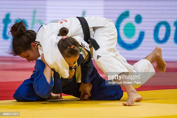 Nathalia Brigida of Brazil is attacked by Leandra Freitas of Portugal during the -48kg preliminary round of the Paris Grand Slam 2015 at the Palais...
