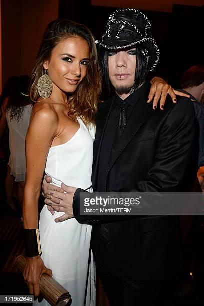 Nathalia Henao and guitarist Dj Ashba of Guns N' Roses attend a reception for the world premiere of 'Michael Jackson ONE by Cirque du Soleil' at...