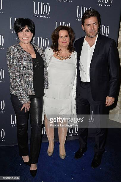Nathalie BellonSzabo president of the Lido cabaret poses with Liane Foly and her husband David Rigaut before the 'Paris Merveilles' Lido New Revue...