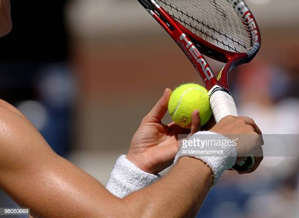 Nathalie Dechy grips a tennis ball before serving to Lindsay Davenport in a women's singles match at the 2005 U S Open in Flushing New York on...