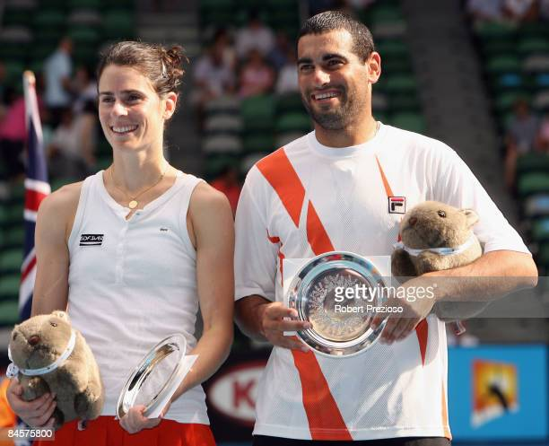 Nathalie Dechy of France and Andy Ram of Israel pose with their trophies after their mixed doubles final match against Sania Mirza and Mahesh...