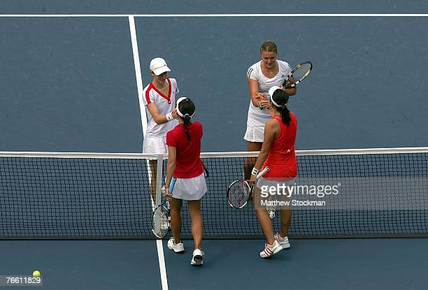 Nathalie Dechy of France and Dinara Safina of Russia are congratulated at the net by YungJan Chan and ChiaJung Chuang of Chinese Taipei after Dechy...
