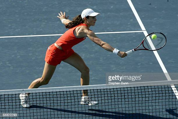 Nathalie Dechy of France hits a forehand against Ai Sugiyama of Japan and Daniela Hantuchova of Slovakia during the Acura Classic at the La Costa...
