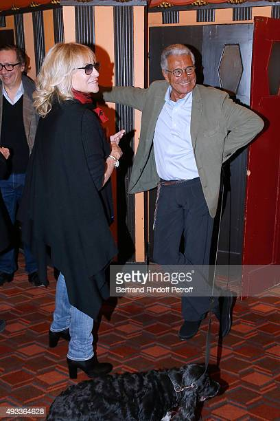 Nathalie Delon and Photographer JeanMarie Perier pose after the 'FlashBack' JeanMarie Perier's One Man Show at Theatre de la Michodiere on October 19...