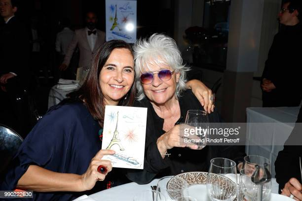 Nathalie Garcon and Catherine Lara attend Line Renaud's 90th Anniversary on July 2, 2018 in Paris, France.