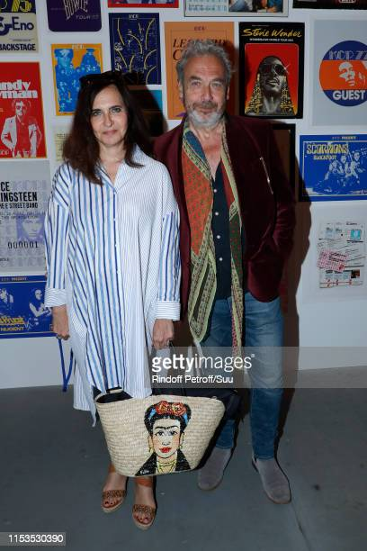 Nathalie Garcon and her husband JeanMarie Duprez attend Albert Koski exposes its RockRoll Posters Collection at Galerie Laurent Godin on June 03 2019...