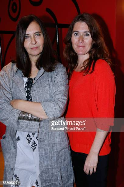 Nathalie Garcon and wife of pascal Legitimus Adriana Santini attend the Cocktail 'Art is doing well' 'L'art se porte bien' Exhibition of the...