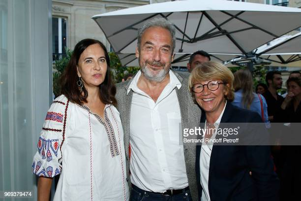 Nathalie Garcon her husband JeanMarie Duprez and Ariane Massenet attend Le Jardin De Joy Cocktail at Hotel Barriere Le Fouquet's on June 7 2018 in...