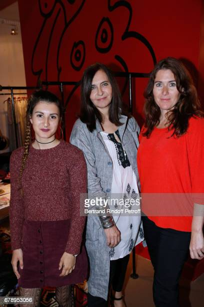 Nathalie Garcon standing between daughter and wife of pascal Legitimus Luna Legitimus and her mother Adriana Santini attend the Cocktail 'Art is...