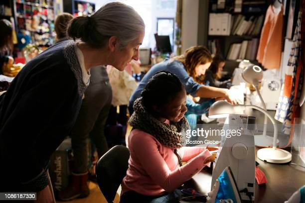 Nathalie Gil of Dorchester center sews during a sewathon to make reusable bags in the Dorchester neighborhood of Boston on Jan 21 2019 On a recent...