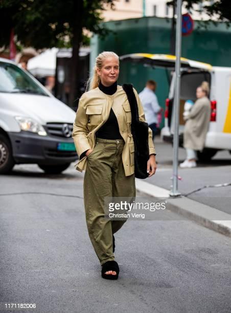 Nathalie Helgerud is seen wearing khaki pants, beige jacket during Oslo Fashion on August 30, 2019 in Oslo, Norway.