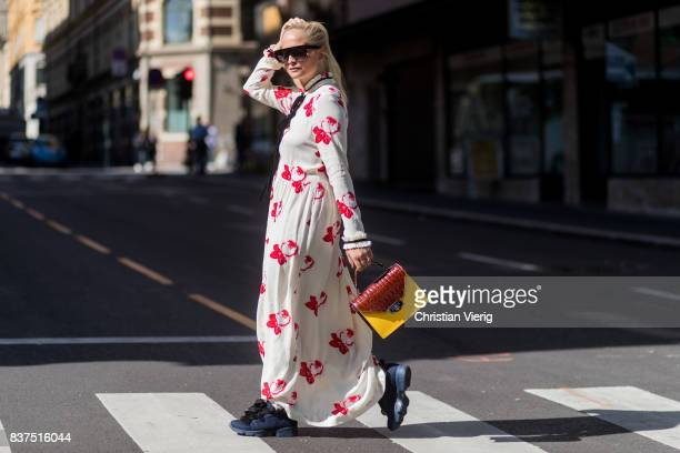 Nathalie Helgerud wearing a bag and Ganni dress outside Moods of Norway on August 22 2017 in Oslo Norway