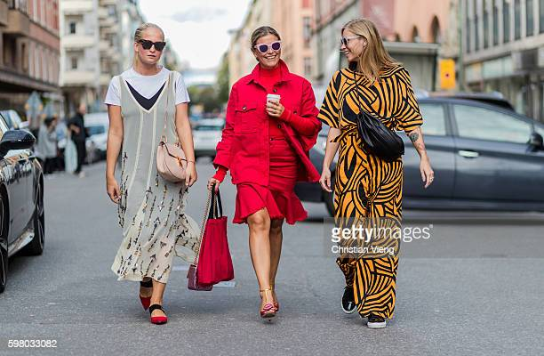 Nathalie Helgerud wearing a By Malene Birger dress and red Mango pointed flats and Chloe bag Janka Polliani wearing a red denim jacket and red skirt...