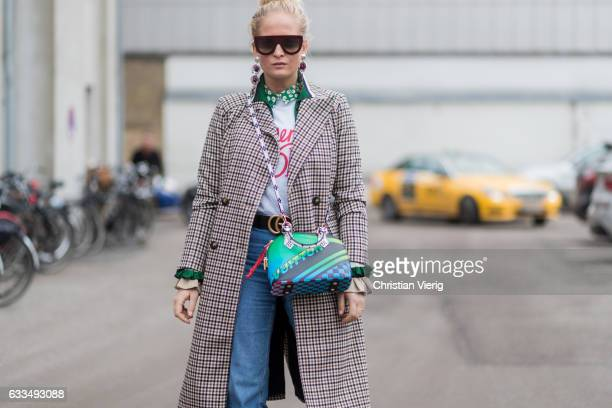 Nathalie Helgerud wearing a Gucci belt Ganni tshirt cropped denim jeans ankle boots outside Baum Pferdgarten at the Copenhagen Fashion Week...