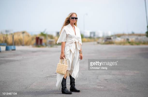 Nathalie Helgerud wearing dress Gucci sunglasses black boots is seen outside JLindeberg during the Copenhagen Fashion Week Spring/Summer 2019 on...