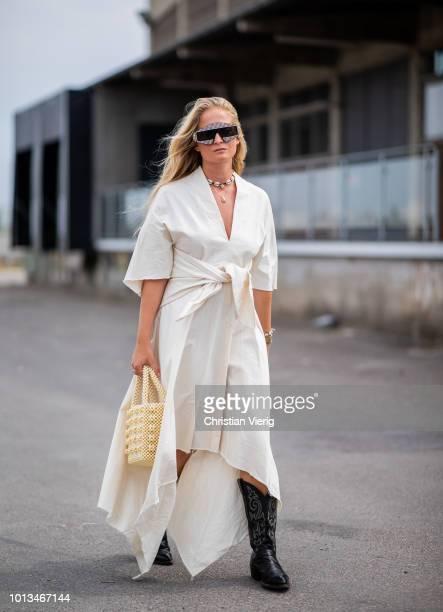 Nathalie Helgerud wearing dress, Gucci sunglasses, black boots is seen outside J.Lindeberg during the Copenhagen Fashion Week Spring/Summer 2019 on...