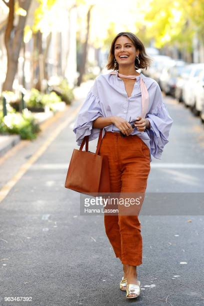 Nathalie Kelley wearing Thierry Coulson blouse All That Remains pants MNZ sandals and Ellery seashell earrings on May 29 2018 in Sydney Australia