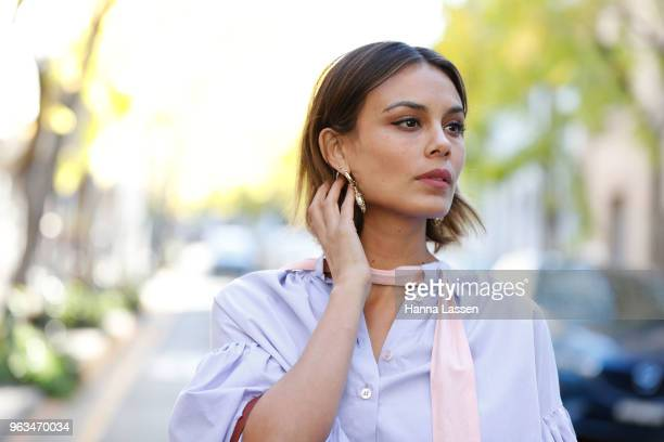 Nathalie Kelley wearing Thierry Coulson blouse, All That Remains pants, MNZ sandals, Cuero & Mor bag and Ellery seashell earrings on May 29, 2018 in...