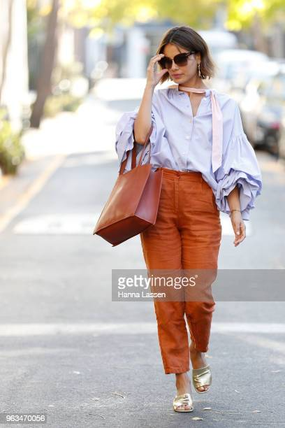 Nathalie Kelley wearing Thierry Coulson blouse All That Remains pants MNZ sandals Cuero Mor bag and Ellery seashell earrings on May 29 2018 in Sydney...