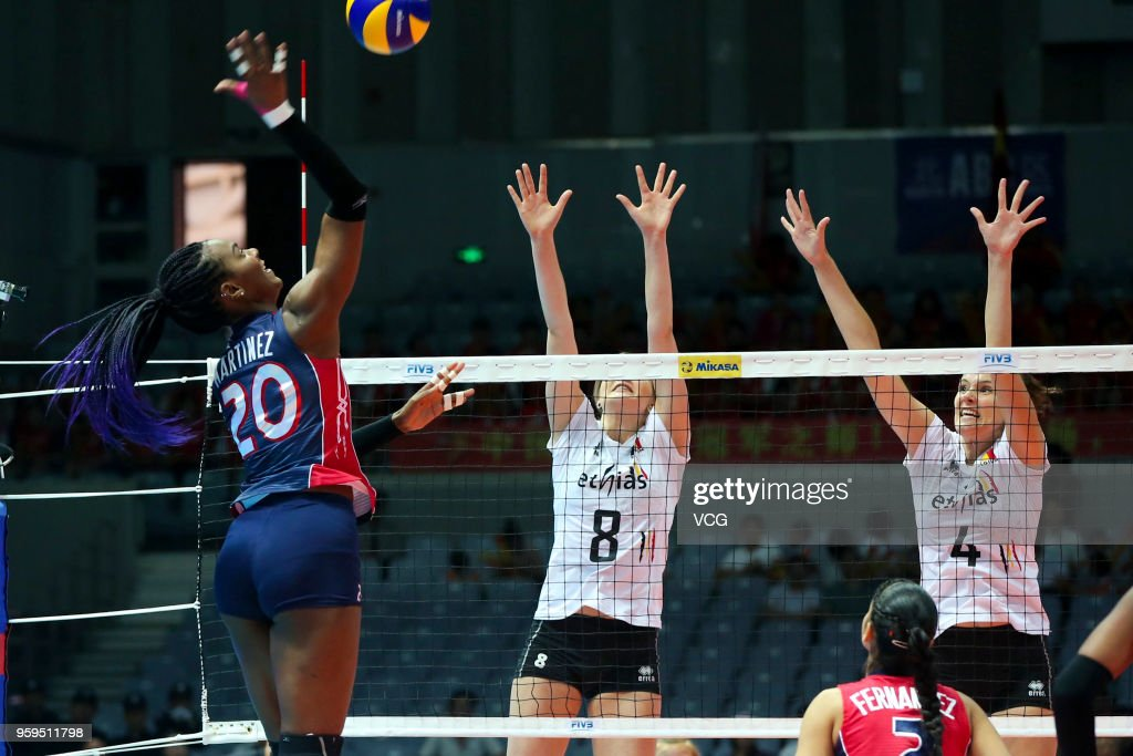 Nathalie Lemmens #4 and Kaja Grobelna #8 of Belgium defend against Brayelin Elizabeth Martinez #20 of the Dominican Republic during the FIVB Volleyball Nations League 2018 at Beilun Gymnasium on May 17, 2018 in Ningbo, China.