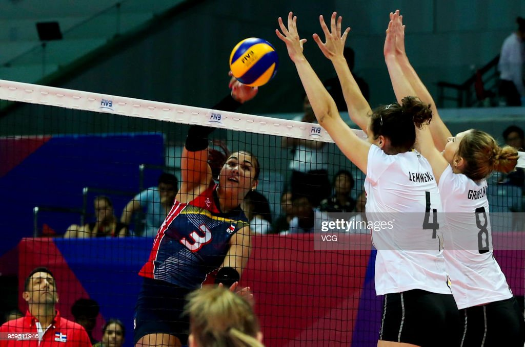 Nathalie Lemmens #4 and Kaja Grobelna #8 of Belgium defend against Lisvel Elisa Eve Mejia #3 of the Dominican Republic during the FIVB Volleyball Nations League 2018 at Beilun Gymnasium on May 17, 2018 in Ningbo, China.