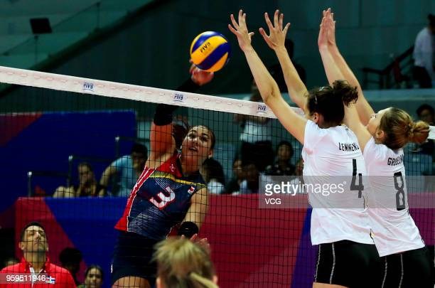 Nathalie Lemmens and Kaja Grobelna of Belgium defend against Lisvel Elisa Eve Mejia of the Dominican Republic during the FIVB Volleyball Nations...