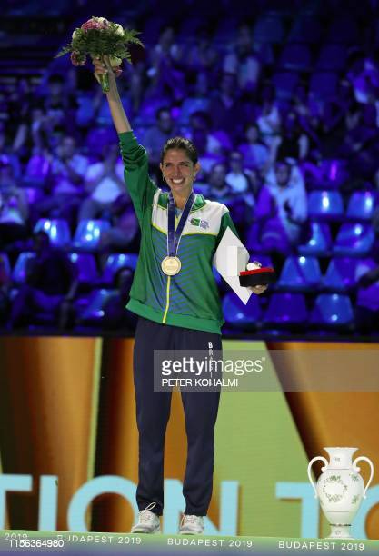Nathalie Mollenhausen of Brazil celebrates after winning the women's individual final of epee competition at the 2019 Fencing World Championships in...