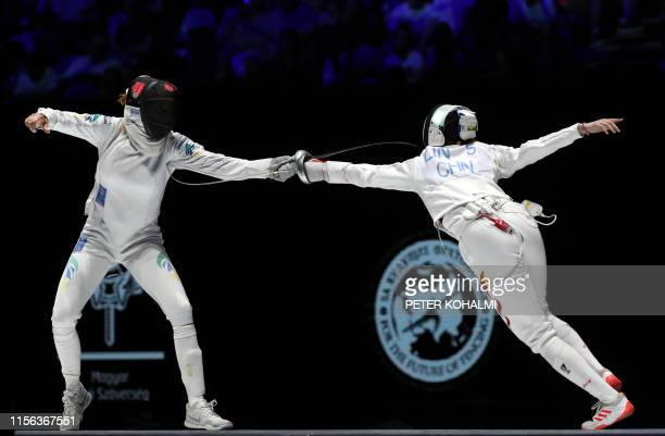 Nathalie Mollenhausen of Brazil competes against Lin Sheng of China during the women's individual final of epee competition at the 2019 Fencing World...