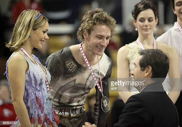 Nathalie Pechalat and Fabian Bourzat of France receive their silver medal in the ice dance competition from ISU president Ottavio Cinquanta at the...