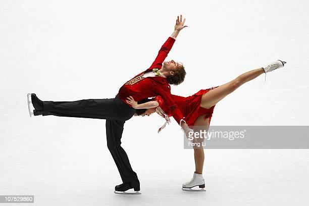 Nathalie Pechalat and Fabian Bourzat of France skate in the Ice Dance Free Dance during ISU Grand Prix and Junior Grand Prix Final at Beijing Capital...