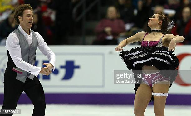 Nathalie Pechalat and Fabian Bourzat of France skate in the Ice Dance Short Dance Program during the 2013 ISU World Figure Skating Championships at...