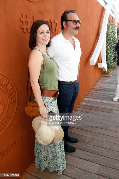 Nathalie Pechalat and her companion actor Jean Dujardin attend the Men Final of the 2017 French Tennis Open Day Fithteen at Roland Garros on June 11...
