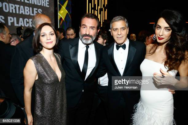 Nathalie PechalatJean Dujardin George Clooney and Amal Clooney pose during the Cesar Film Awards Ceremony at Salle Pleyel on February 24 2017 in...